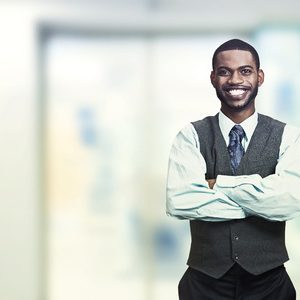 young businessman with is arms crossed.