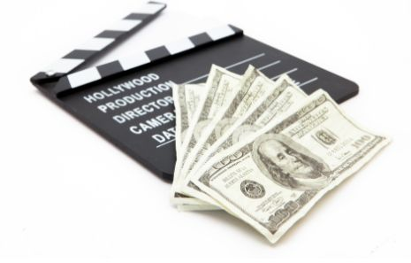 film slate and paper money representing the cost of video learning