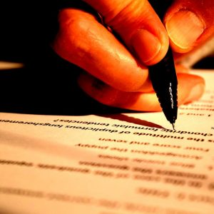 test management: closeup of hand on test paper