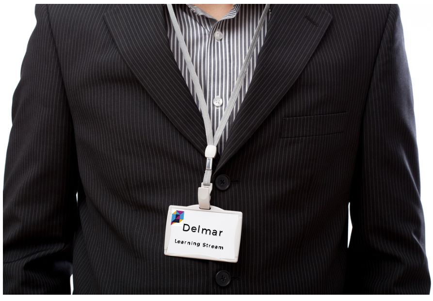 Attendee wearing a name badge with name and company