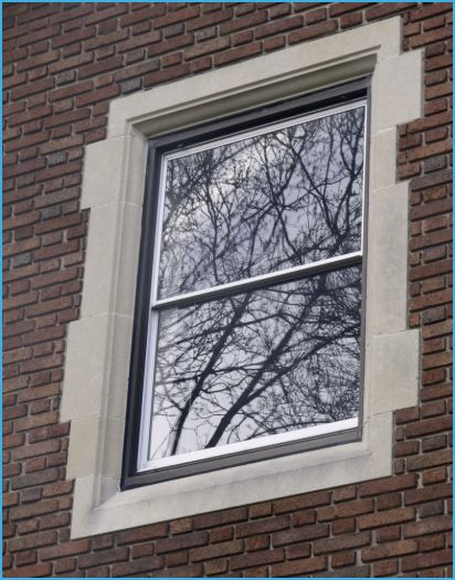 A photo of a window in a brick building