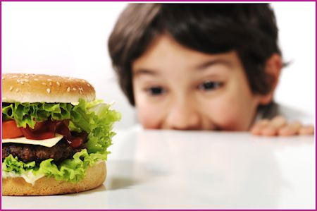 child admiring a cheeseburger