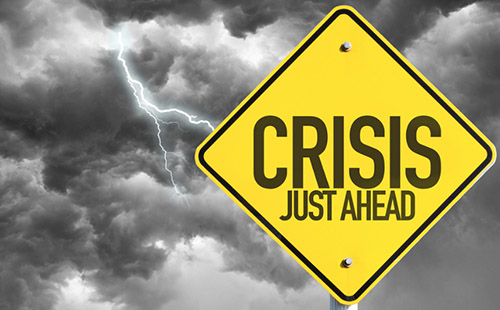 Warning Sign says Crisis Just Ahead