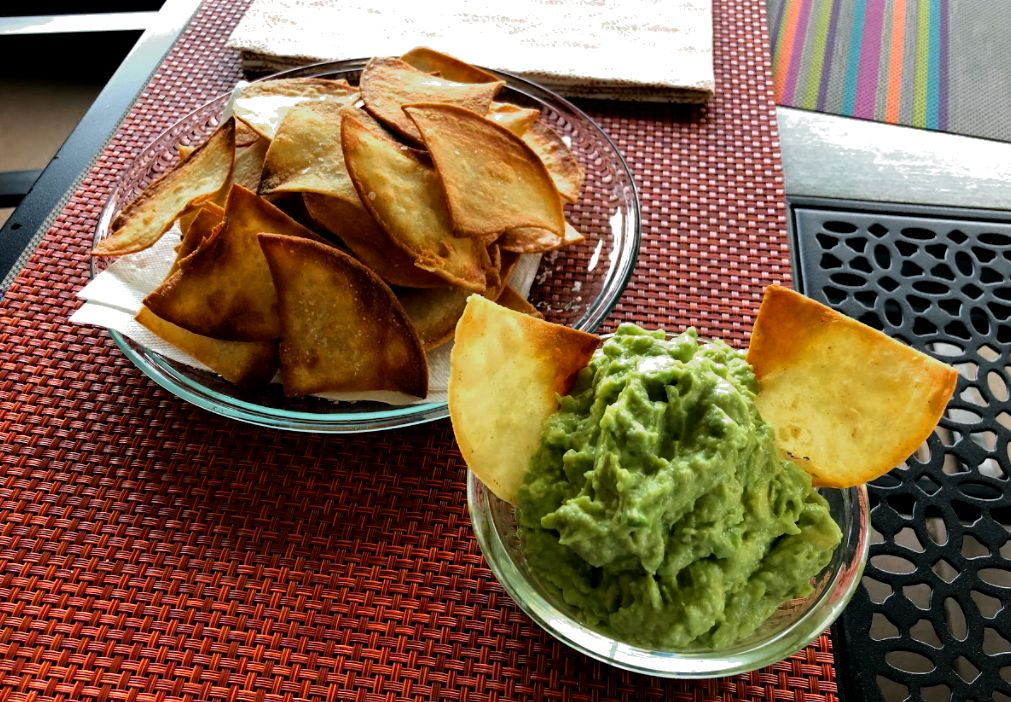 Guacamole and chips on a table